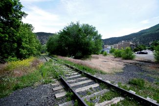 "A makeshift footpath over the railroad side tracks, known as the ""wye,"" now links Eighth Street, shown in the upper righthand corner next to Glenwood Springs City Hall, with Seventh Street and the bridge over to Midland Avenue. The city and the Colorado Department of Transportation both want to build a street extension beneath the tracks, but for different reasons."