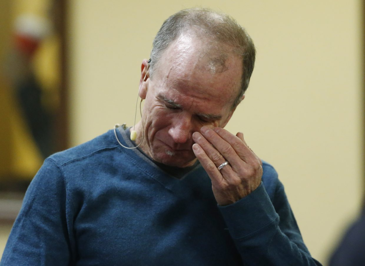Co-pastor Scott Dontanville of the Hope Chapel fights back tears before taking part in service early Sunday, in northeast Colorado Springs. University of Colorado-Colorado Springs police officer Garrett Swasey, who was one of the three victims of a shooting at a nearby Planned Parenthood clinic Friday, was a member of the congregation.