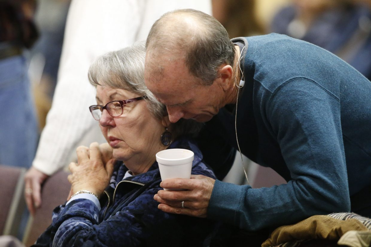 Scott Dontanville, front, co-pastor of the Hope Chapel, consoles a congregant before service early Sunday, in northeast Colorado Springs. University of Colorado-Colorado Springs police officer Garrett Swasey, who was one of the three victims of a shooting at a nearby Planned Parenthood clinic Friday, was a member of the congregation.