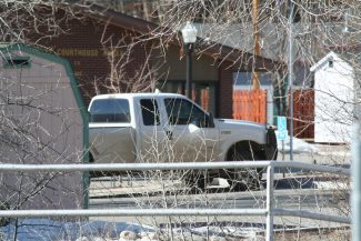 In this photo provided by The Chaffee County Times a truck is parked in Buena Vista, Colo., Tuesday, Feb. 18, 2014. Chaffee County Sheriff Pete Palmer said a member of the library's maintenance staff discovered a suspected bomb in the bed of the truck. (AP Photo/The Chaffee County Times, Mary Lee Bensman)