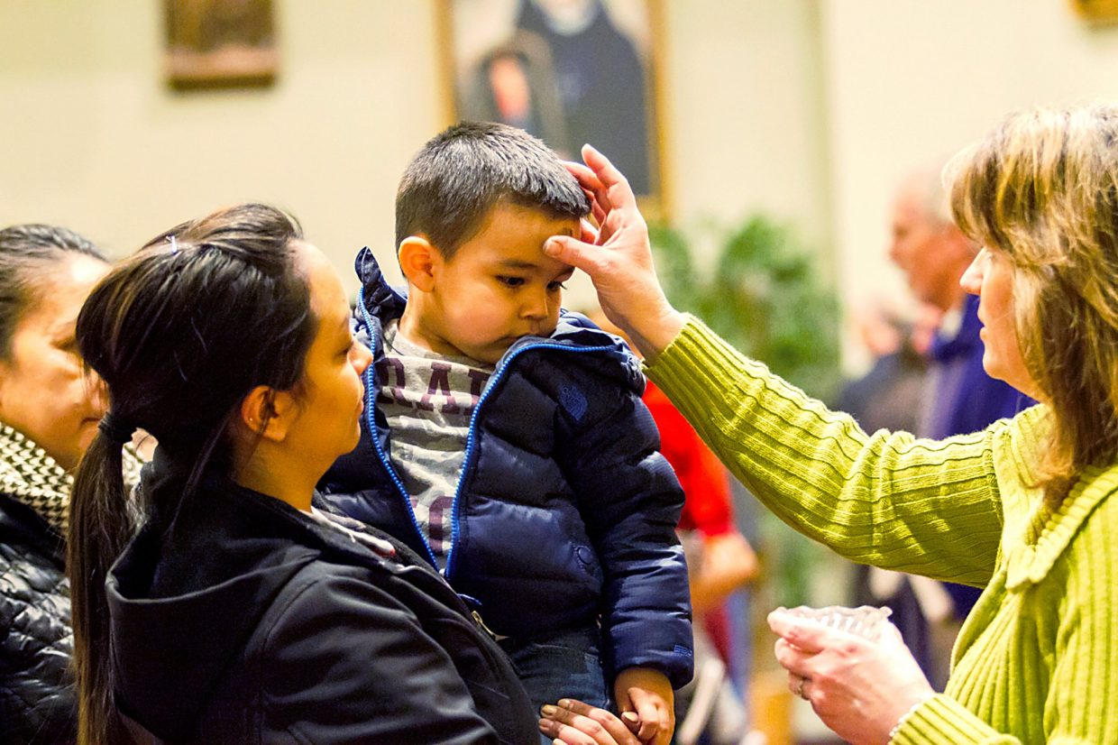 Participants of Ash Wednesday received a cross on their forehead from the ministers and Pastor Bert Chilson of St. Stephens Catholic church on Wednesday evening.