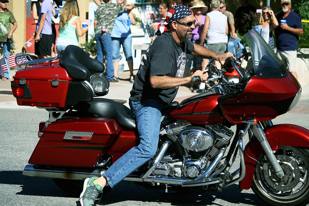 A visibly excited Bob Byram of New Castle shows off his 2006 Harley-Davidson Road Glide in the Burning Mountain Festival parade.