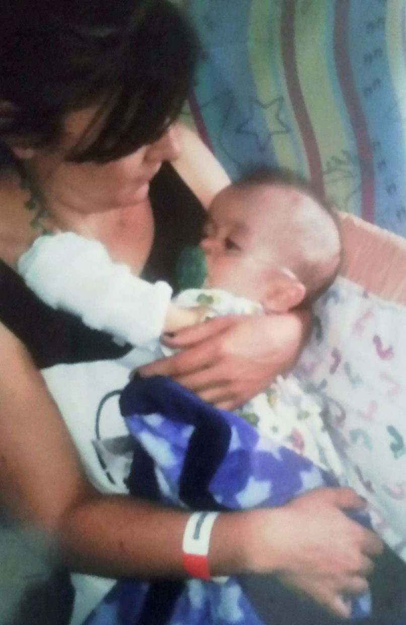 Irene Caraveo Flores holds her son Daniel.