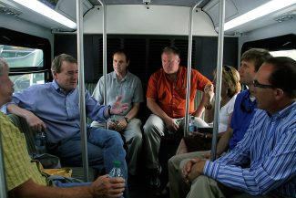 Senator Michael Bennet (second from left) responds to a question posed to Gould Construction president Mark Gould (far right) aboard an upvalley RFTA bus Tuesday afternoon.
