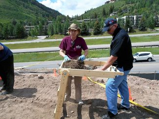 Dr. Melissa Conner of Colorado Mesa University and Rusty Jacobs of the Vail Police Department work at the Lionshead Inn site on Friday as part of the investigation of skeletal remains.