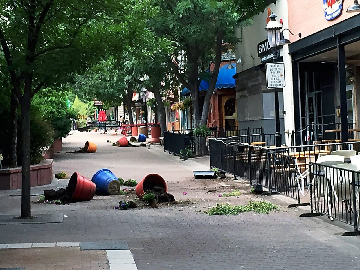 Flower pots along the 700 block of Grand Avenue in Glenwood Springs were found overturned and damaged July 19.