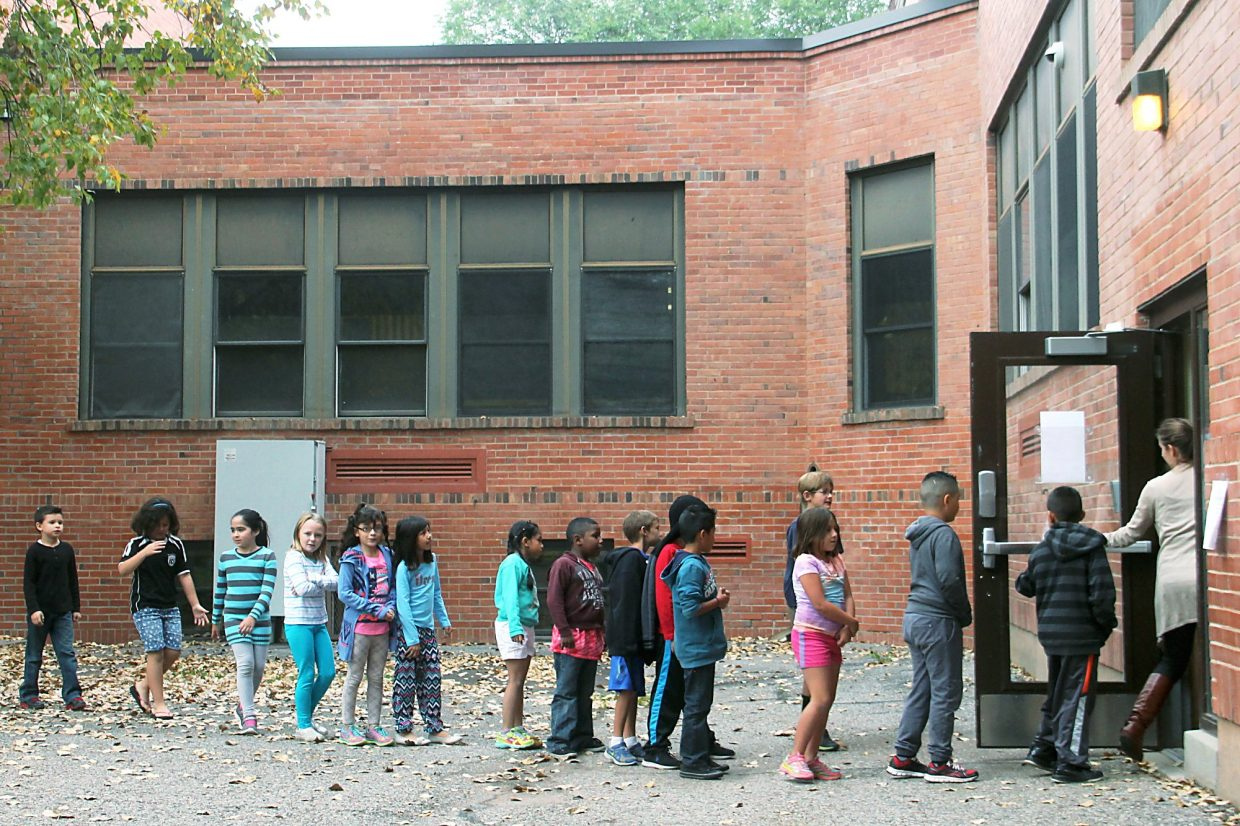 Class transitions at Glenwood Springs Elementary School include children walking between buildings. The school is to be fully renovated under the school district's $122 million bond issue approved by voters in November.