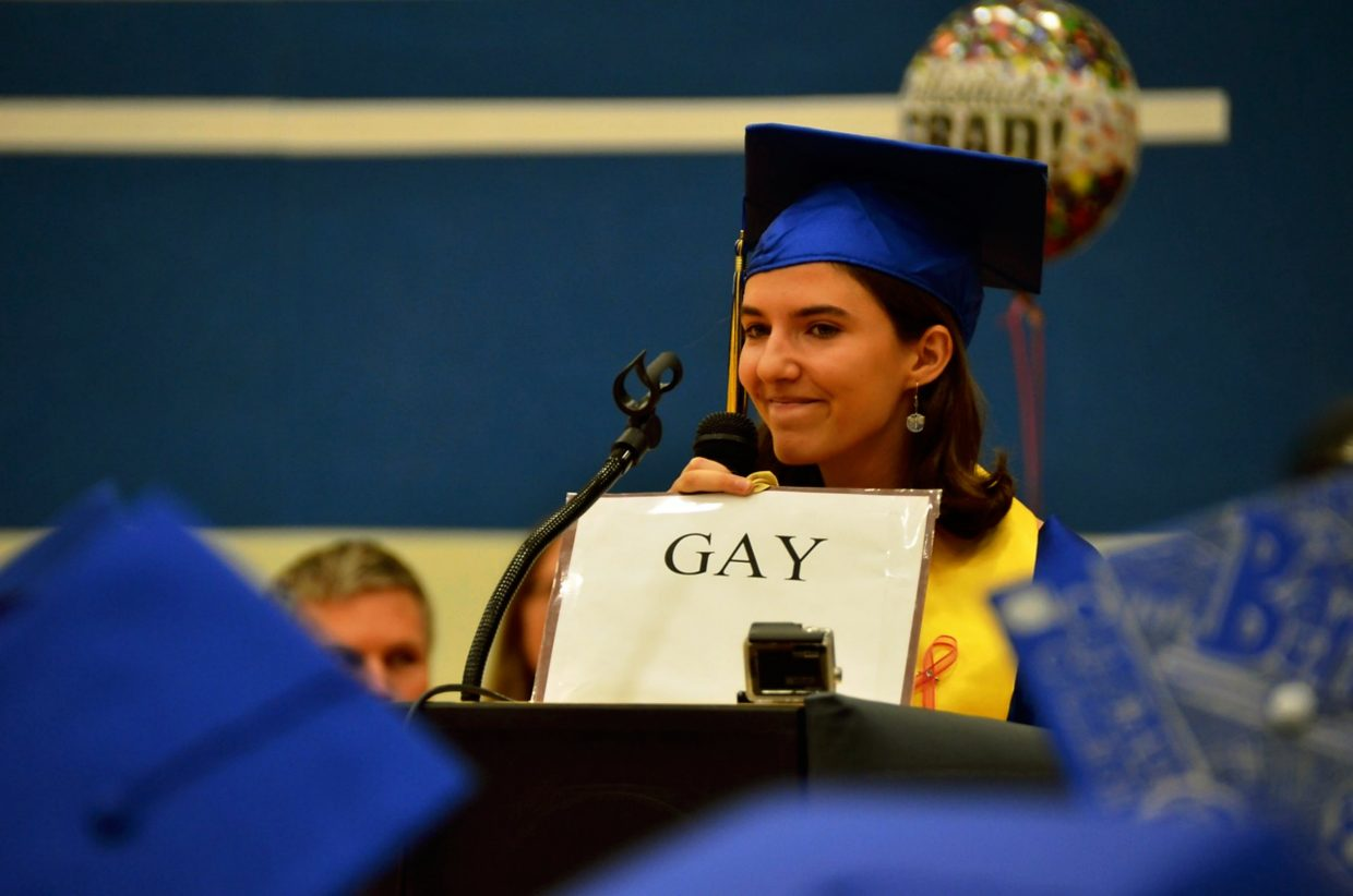 Roaring Fork High School valedictorian Emily Bruell holds up a sign identifying herself as gay during 2015 commencement. She received a standing ovation from the crowd.