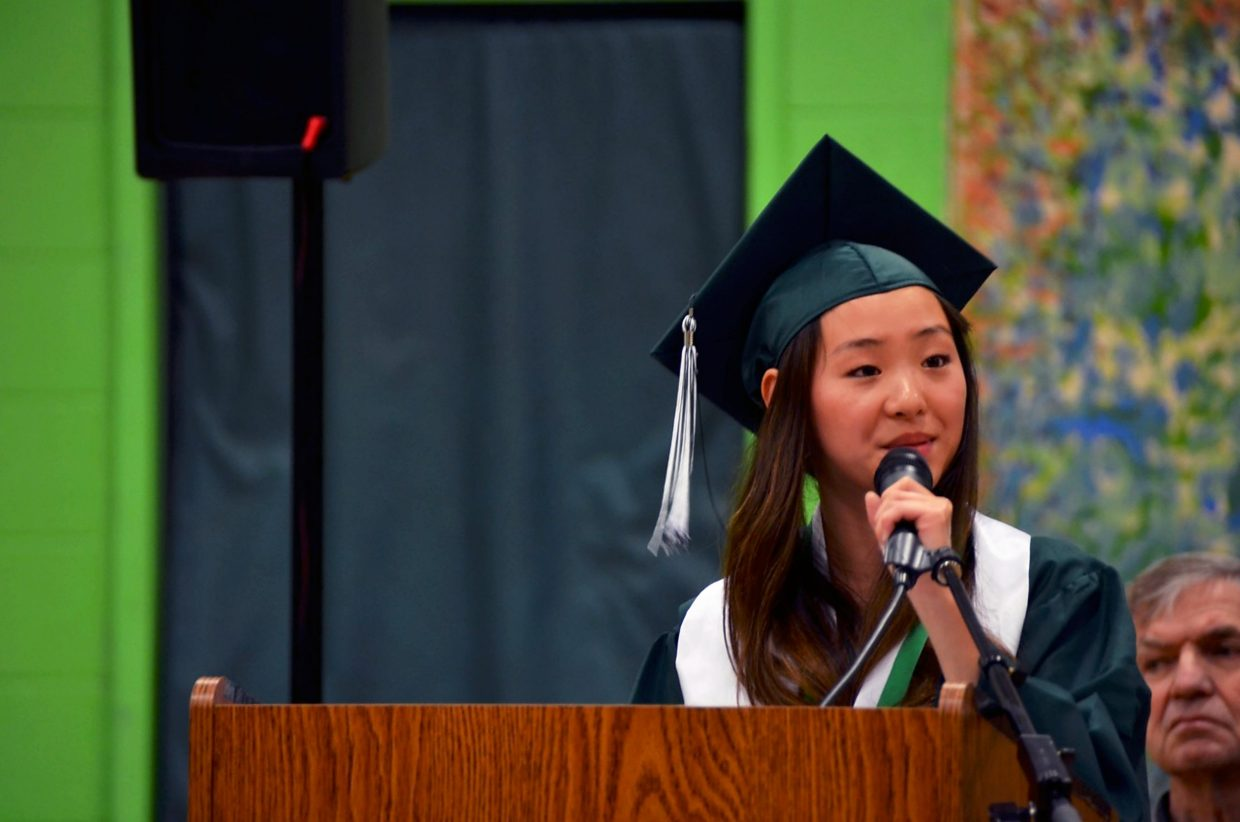 Class valedictorian Malia Machado delivers her speech during commencement at Bridges High School.