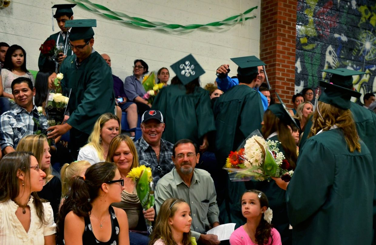 Bridges students were asked to hand flowers to thank the people who helped them throughout their high school careers.