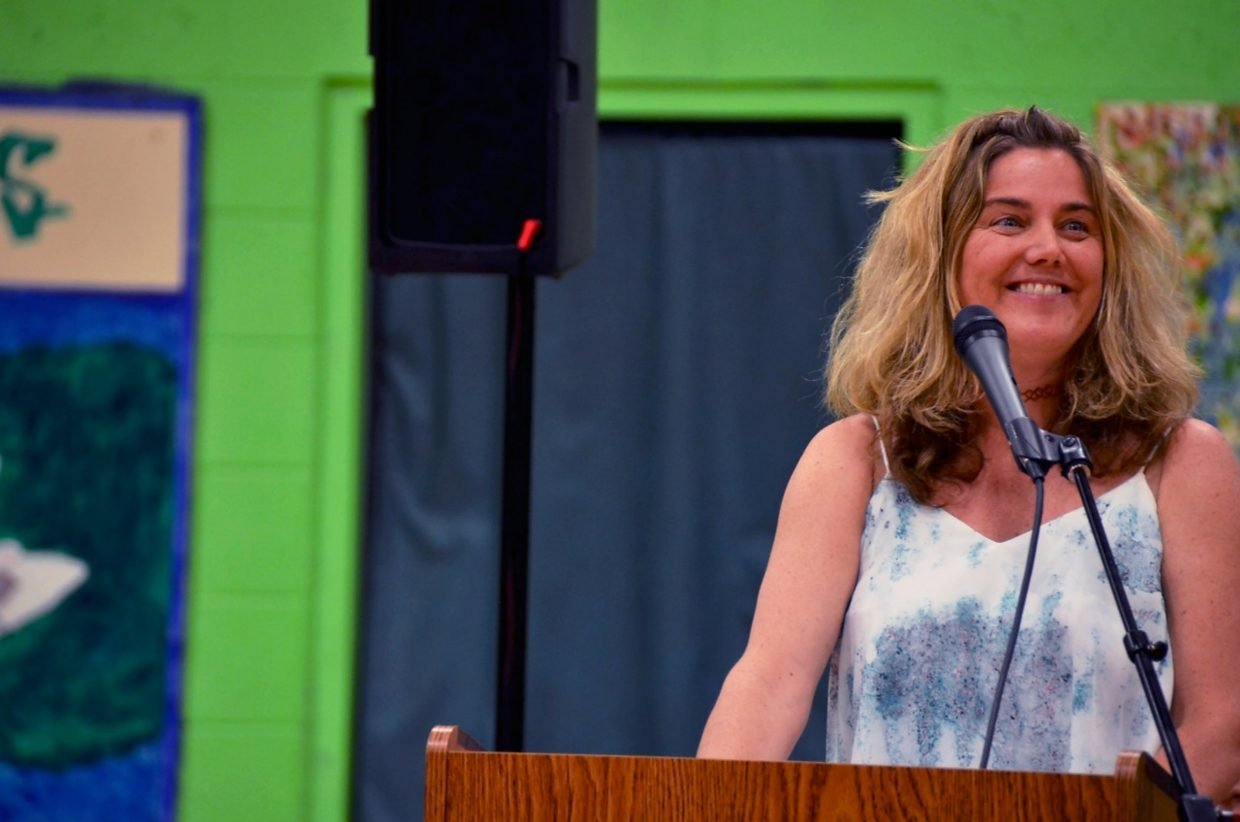 Bridges teacher Maggie Riley gives the commencement speech to the class of 2015 on Friday evening