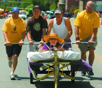Bed racing is back at  the Burning Mountain Festival. In a past event, representing the Lions Club of New Castle, from left, Bryan Vashus,Nathan Pottberg, Larry Rose and Mic Basa push Tori Palmer down Main Street in New Castle.