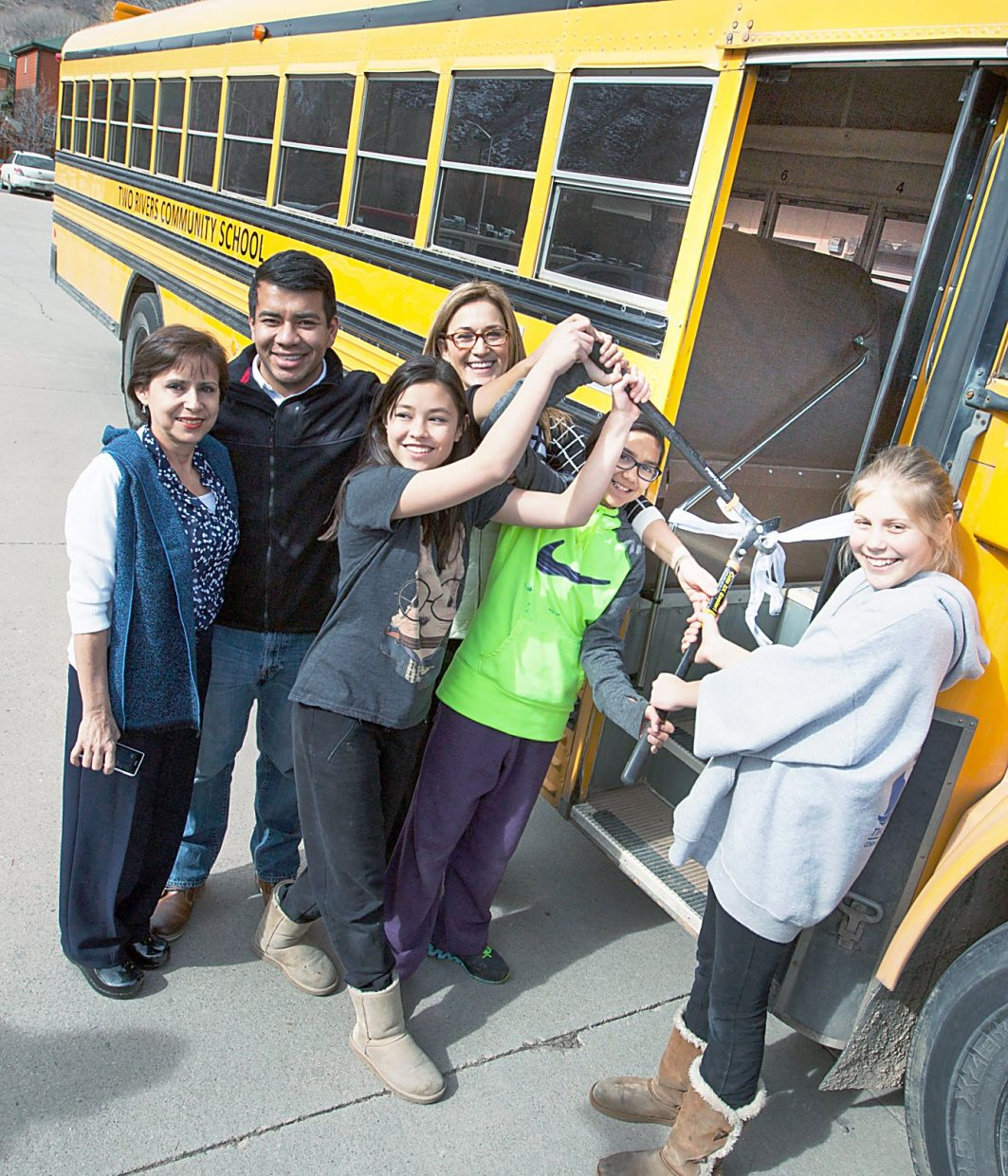 Two Rivers Community School students board their new school bus