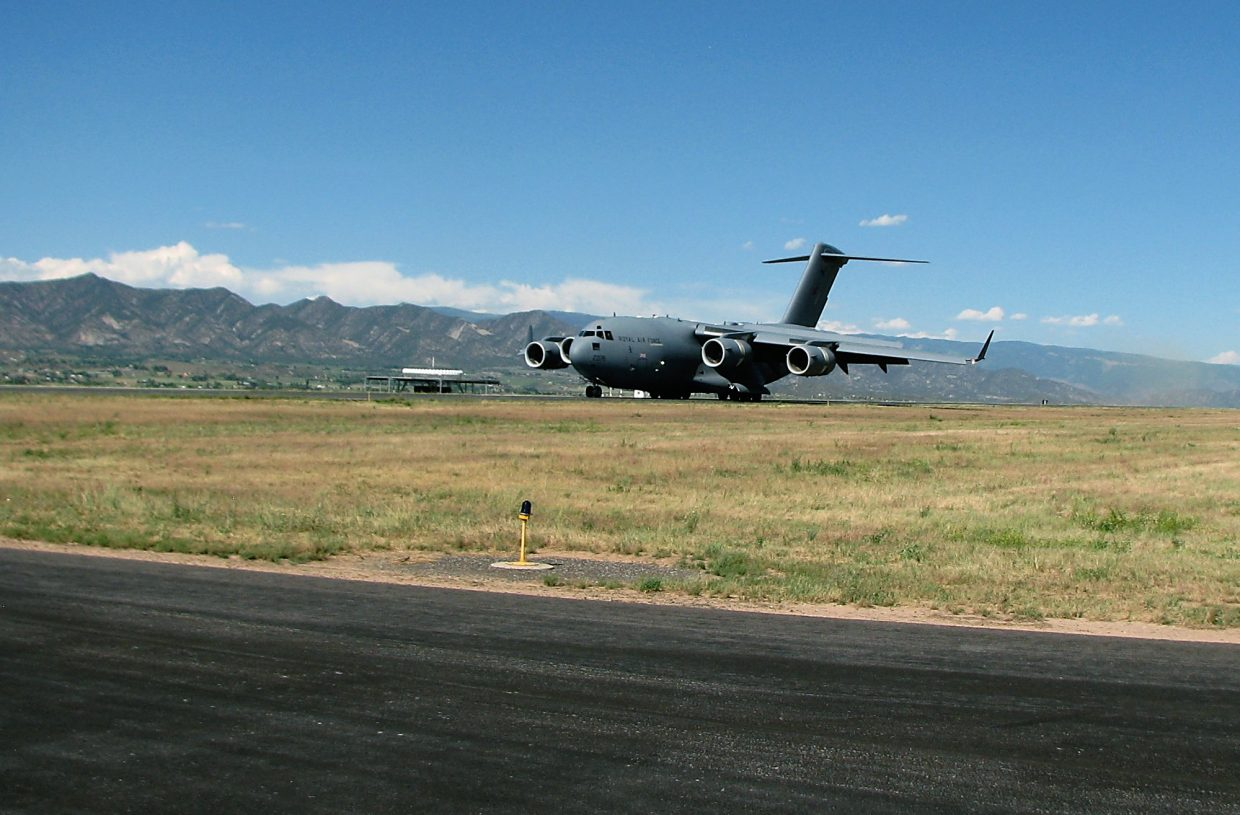 The C-17 begins to taxi after landing Thursday in Rifle.