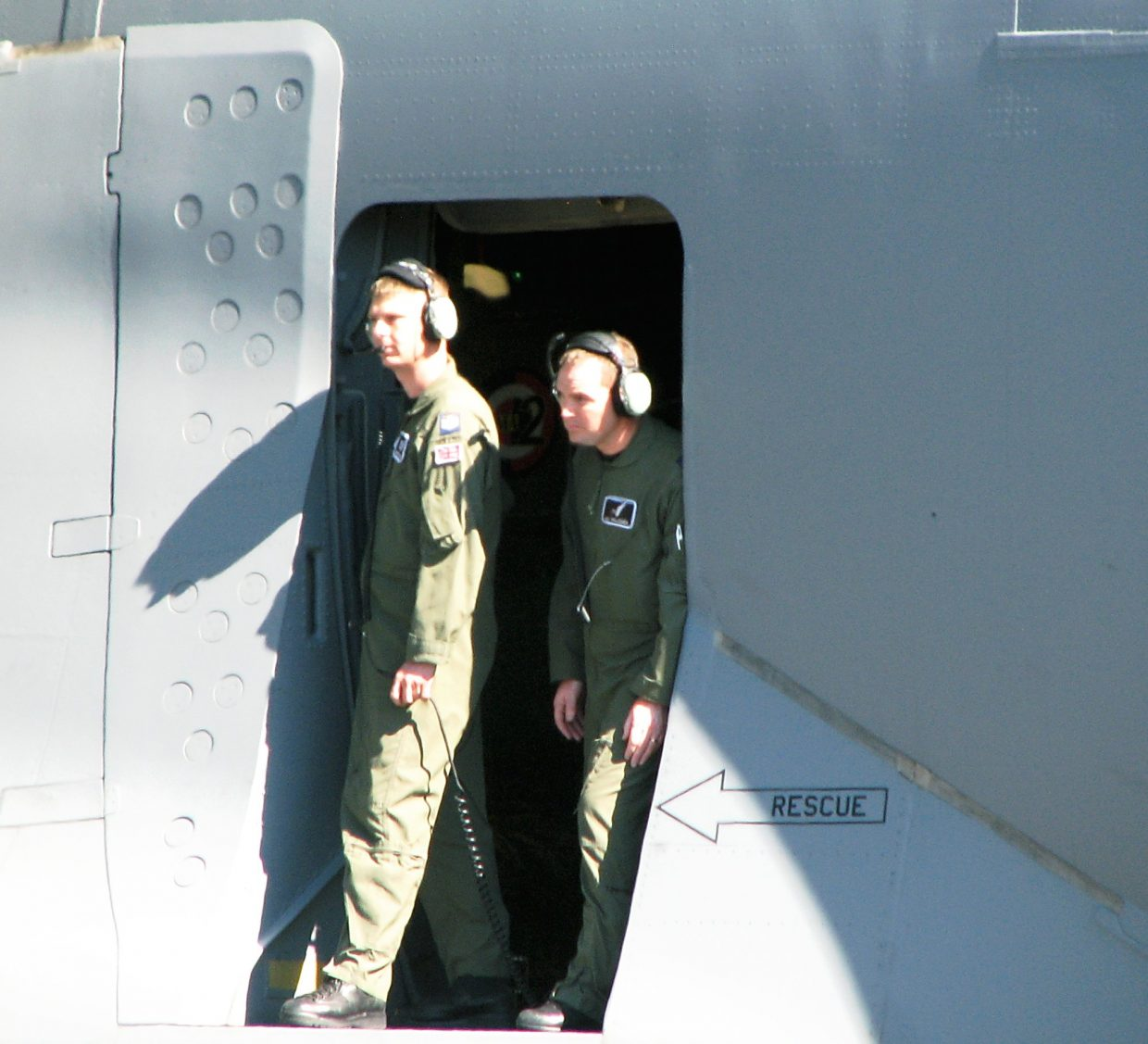The cargo plane's crew emerges after landing in Rifle.