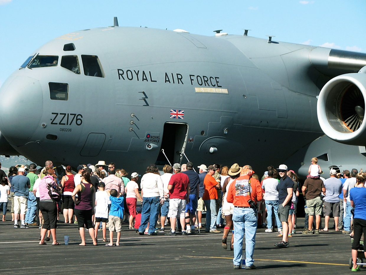 Curious Coloradans get a look at the Royal Air Force cargo jet that landed Thursday in Rifle.