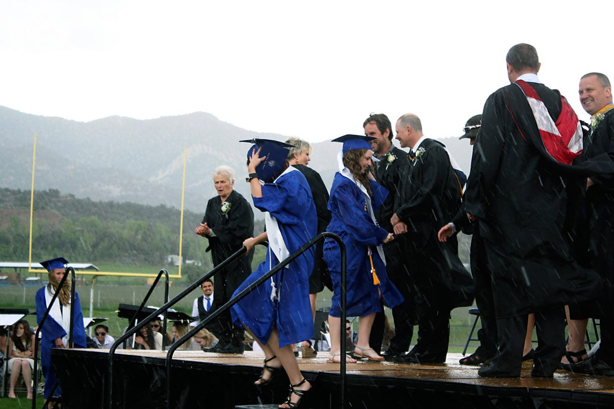 Rain continues to fall during the Coal Ridge High School Graduation Ceremony Saturday.