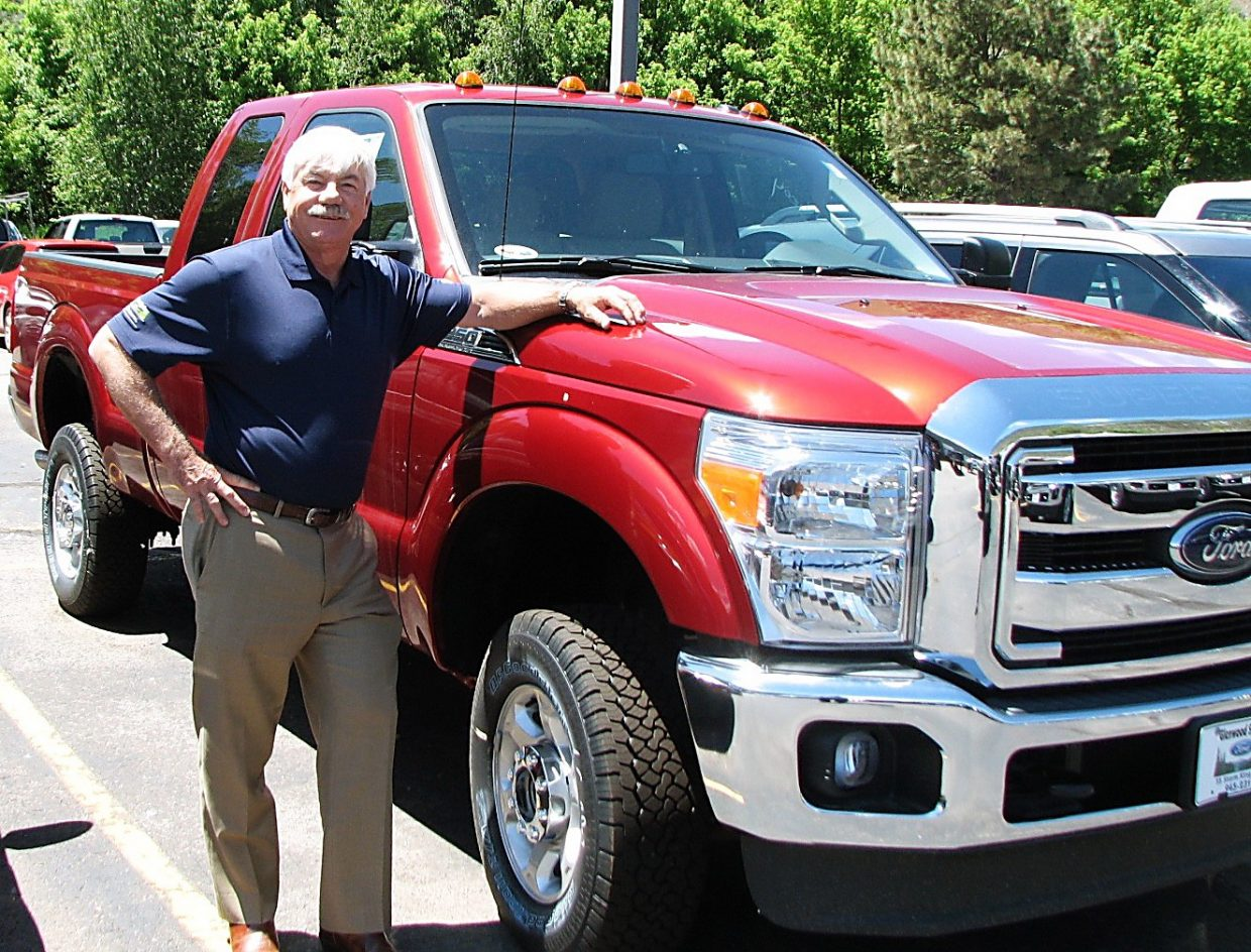 Jeff Carlson, 2016 National Automobile Dealers Association chairman, stands by a Ford F-series truck. As president of Glenwood Springs Ford and Summit Ford, Carlson and his dealerships enjoy the longrunning popularity of the F-series, America's bestselling vehicle for more than 30 consecutive years.