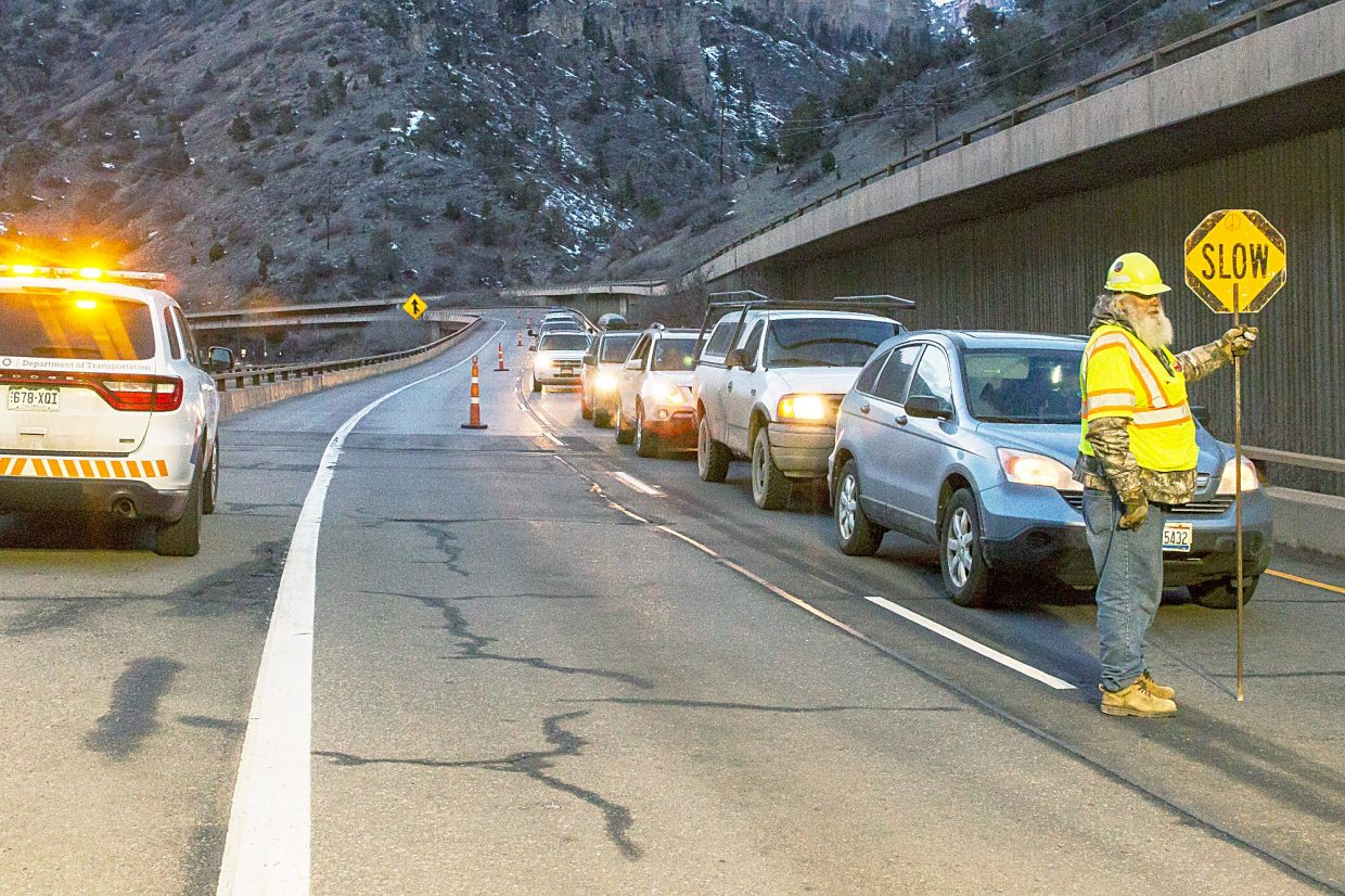 The first line of cars waits for the pilot car to take them eastbound through Glenwood Canyon on Feb. 21 following a six-day closure of I-70 east of Glenwood Springs.