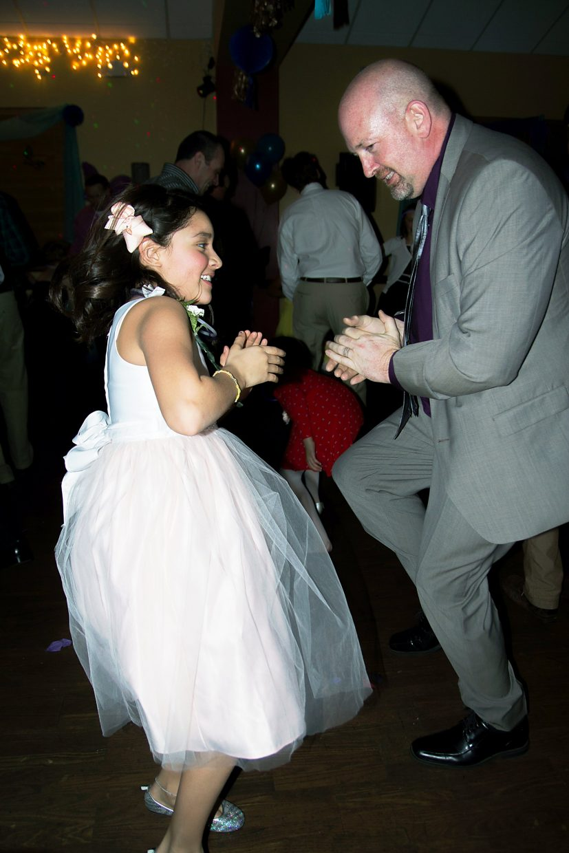Greg Hire and his grand daughter Eva Williams(9) danced till they couldn't dance anymore at the Daddy Daughter Dance Friday night at the Glenwood Springs Community Center.