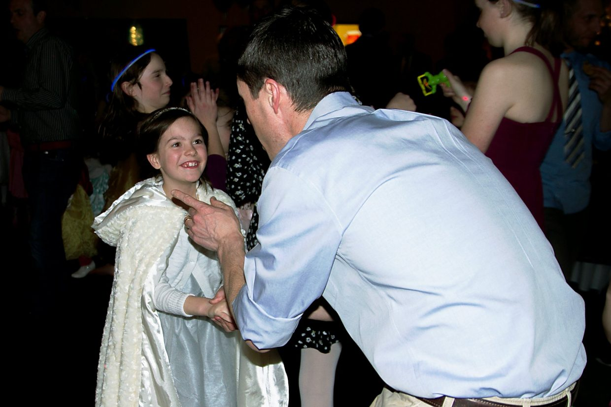 Ella Thornal(8) and her dad Ben dance together at the Glenwood Springs Community Center during the Daddy Daughter Dance friday night.