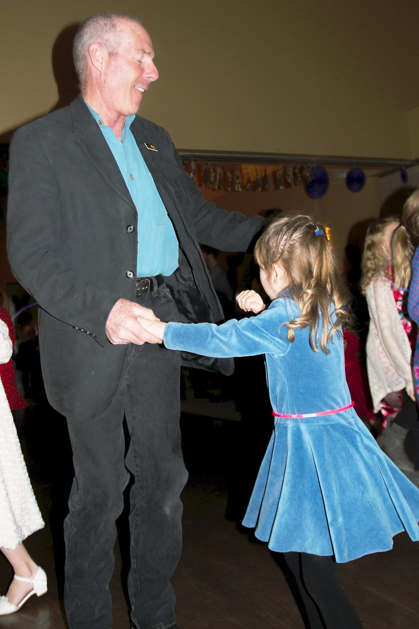 Kevin McDevitt and his granddaughter Natalie(4) have a blast dancing the night away at the Daddy Daughter Dance Friday night.
