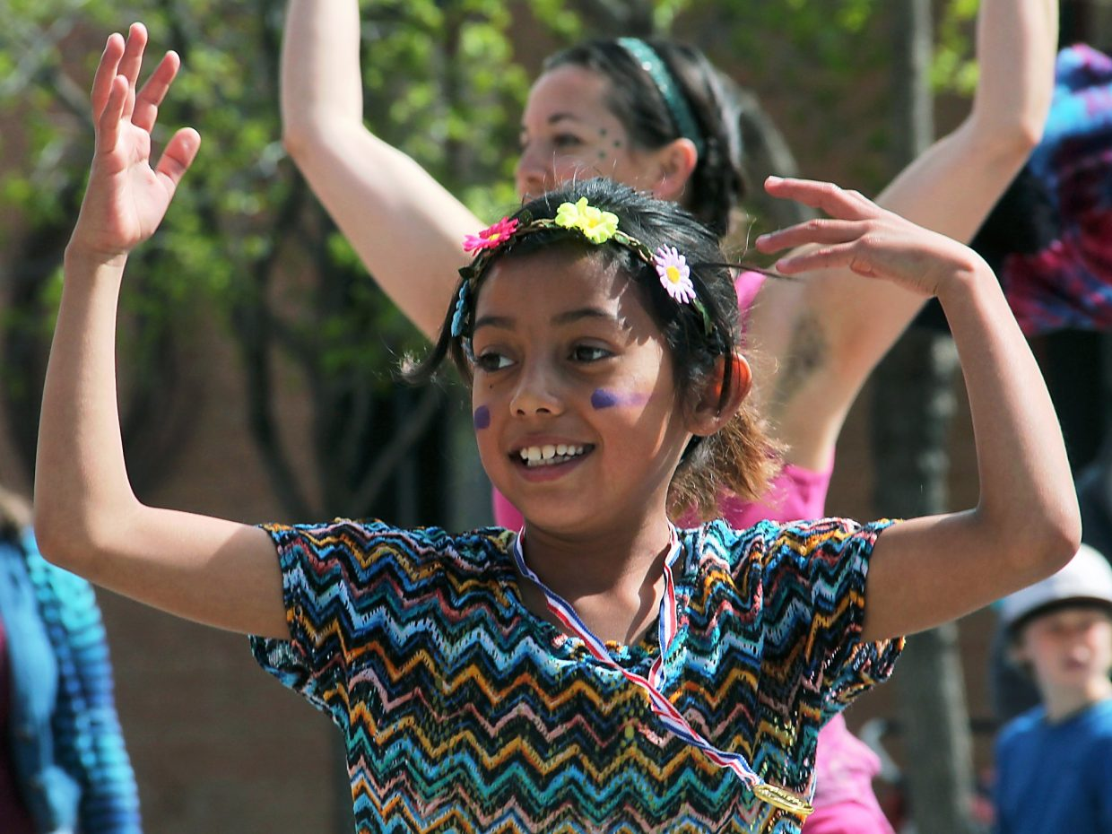 The sunny weather lingered just long enough Saturday morning for Sonia Martinez-Morales and her fellow dancers to lead the annual Dandelion Day parade down Carbondale's Main Street.