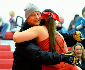 Glenwood Springs High School Athletic Director Craig Denney hugs a student at Spencer-Chavez Memorial Gymnasium on Friday during a girls basketball game between Palisade and Glenwood Springs. Denney, who is in treatment for Burkitt's lymphoma, attended his first events at the high school since his diagnosis on Nov. 18.