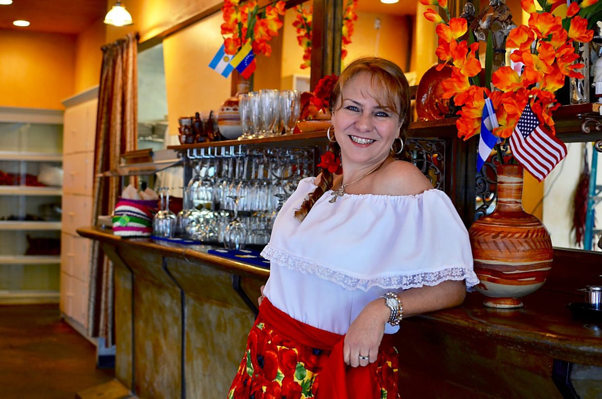Eloisa Duarte in her server uniform at the Cocina del Valle in Basalt.