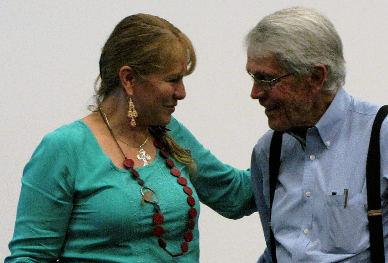 Eloisa Duarte and George Stranahan praise each other during a graduation ceremony for the Valley Settlement Project's Lifelong Learning program.
