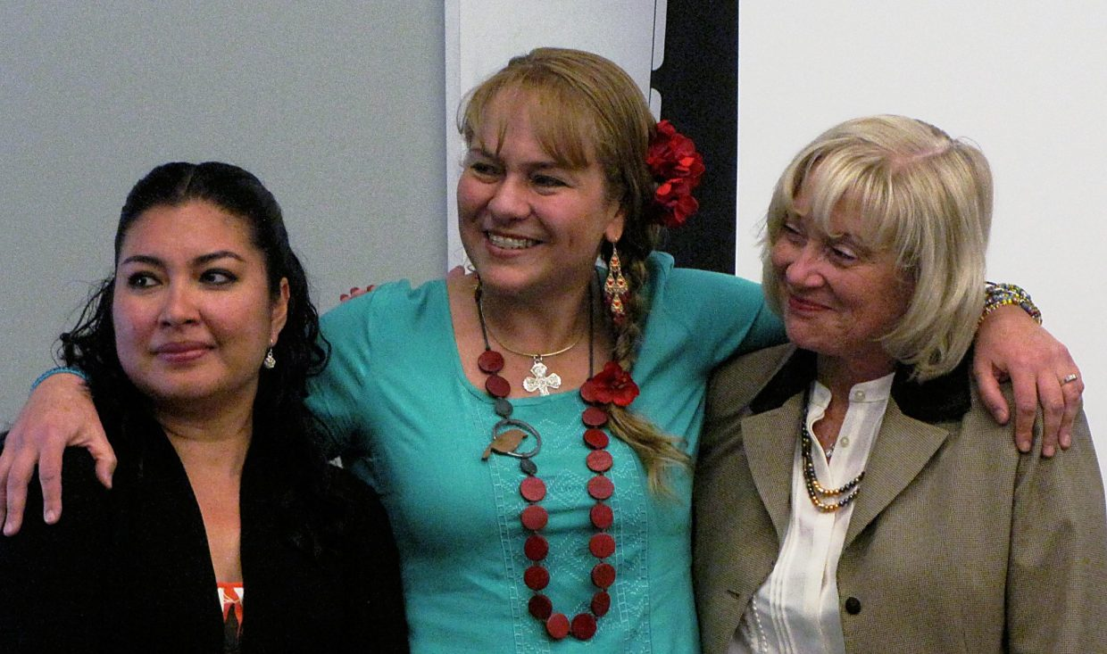 Eloisa Duarte (center) enjoys a moment at an adult education ceremony with Alejandra Megaña (left) and Roaring Fork School District Superintendent Diana Sirko.