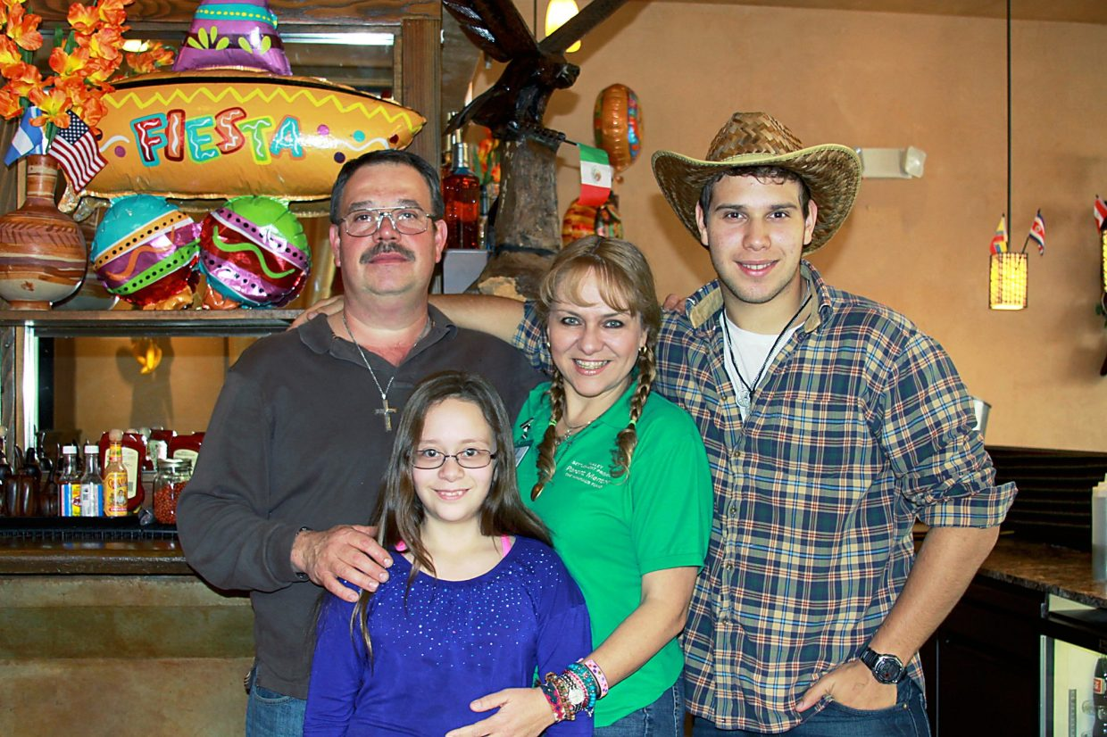 Eloisa Duarte with her family, husband Mario Alverde and children Esmeralda and Mario.
