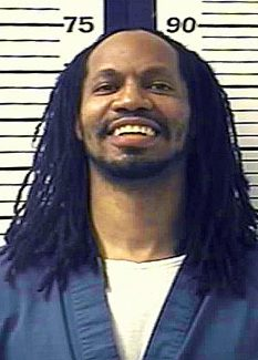FILE - This undated photo provided by the Colorado Department of Corrections shows Nathan Dunlap. Dunlap is on death row for the slayings of four people in a Denver-area Chuck E. Cheese restaurant. He was convicted and sentenced to die in 1996, and his last guaranteed appeal was rejected this year. His execution is scheduled for the week of Aug. 18, 2013. (AP Photo/Colorado Department of Corrections, File)