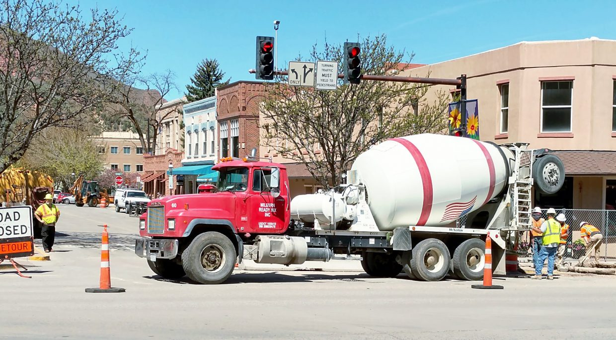 Crews work Wednesday at Eighth Street and Grand Avenue in Glenwood. The water line work