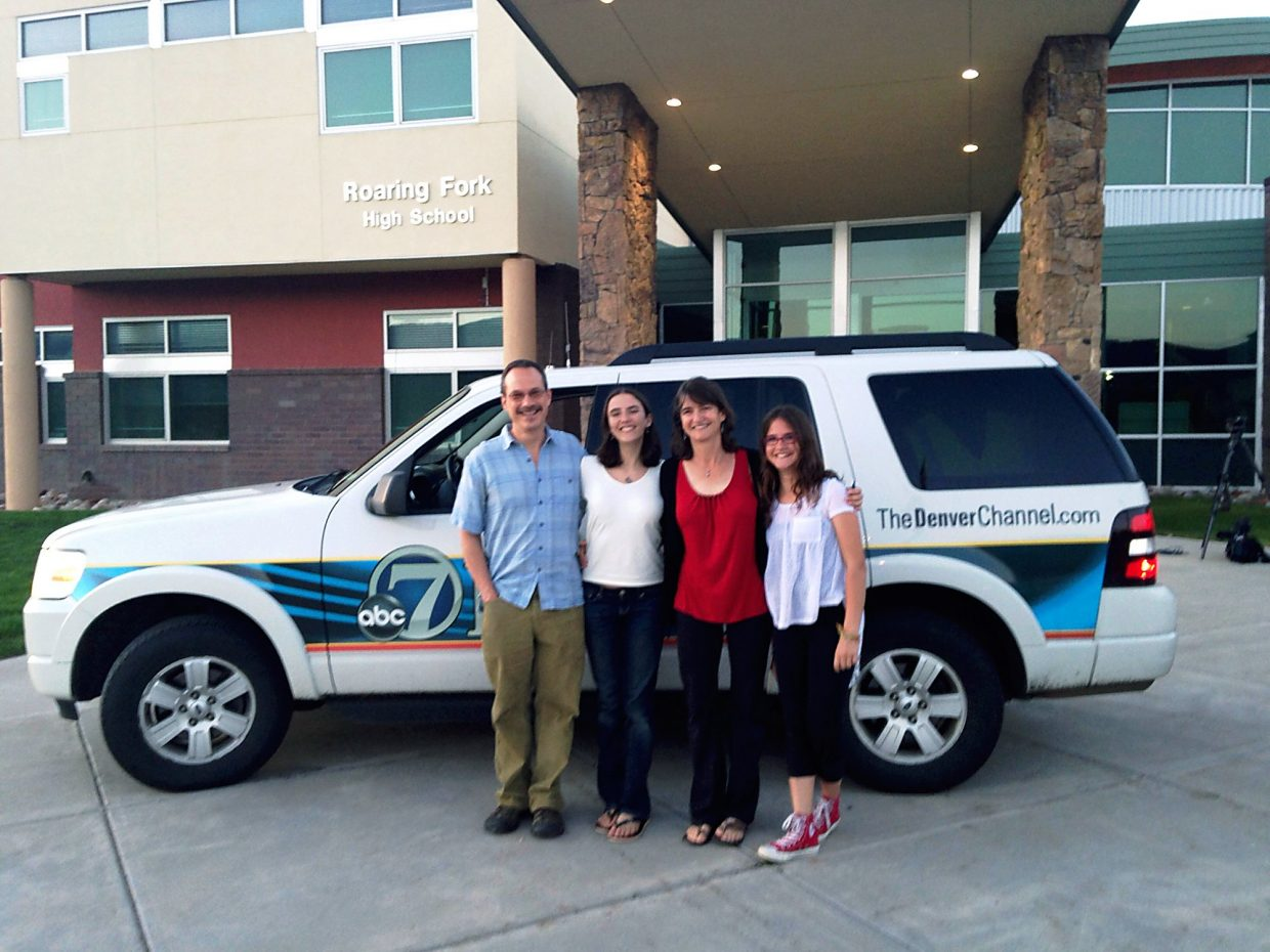 Emily, center, with her father, Marc, mother, Debbie, and sister, Renee, with a Denver TV news truck in front of Roaring Fork High School.