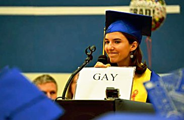 One of three valedictorians, Emily Bruell held up a sign identifying herself as gay during commencement at Roaring Fork High School on May 30. She received a standing ovation from the crowd.