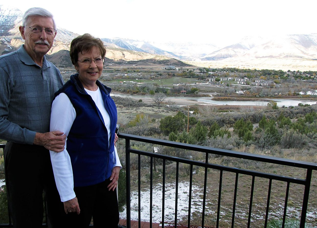 Bill and Eleanor Nelson stand on their deck in Battlement Mesa overlooking the planned site for a natural gas drilling well pad.