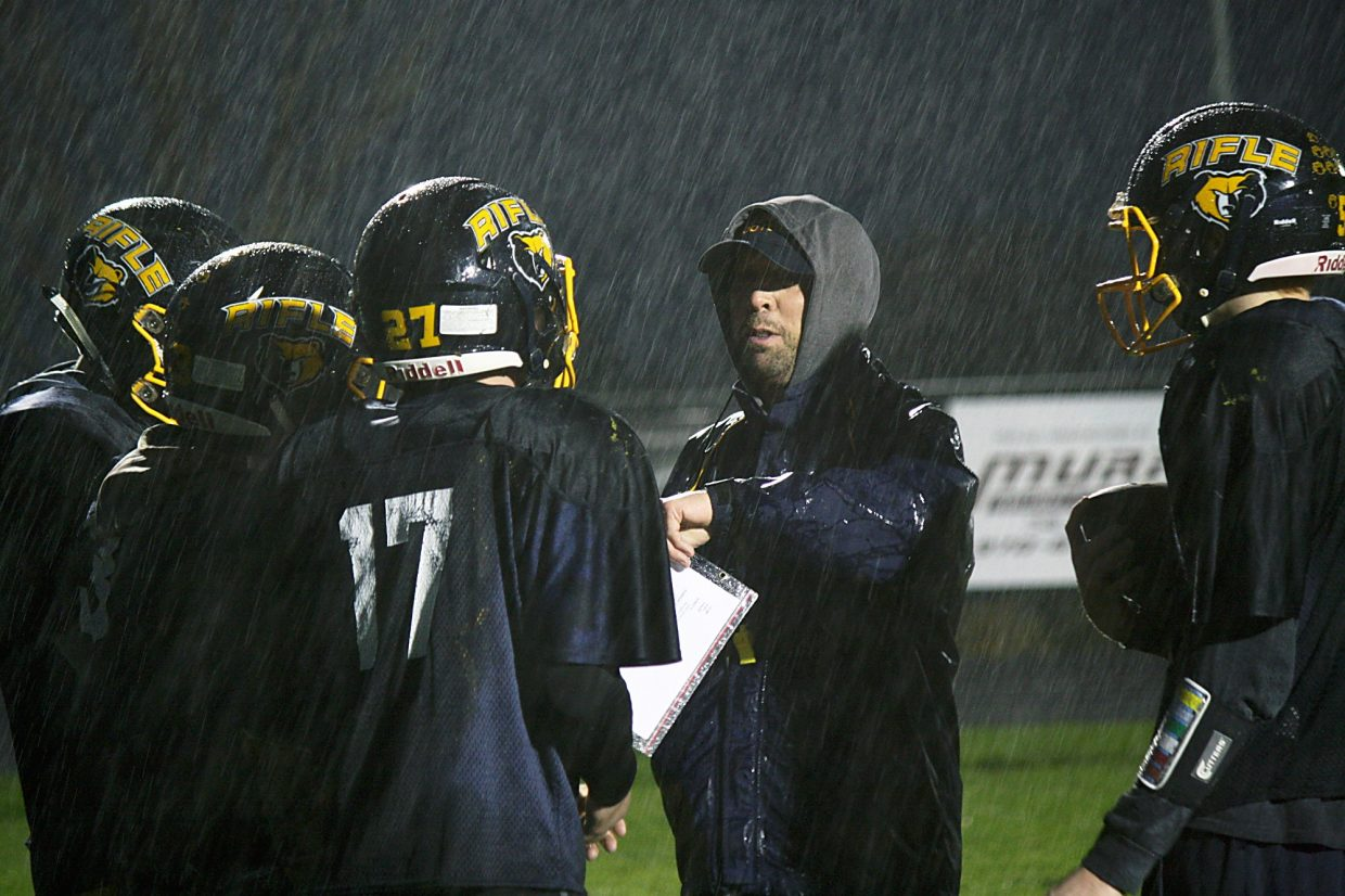Rifle head coach Damon Wells gives instructions during a recent practice at Bears Stadium. Rifle begins the state playoffs Friday against Discovery Canyon.