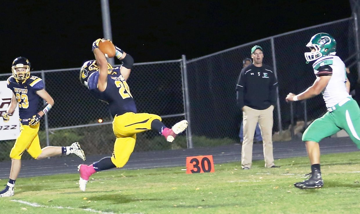 Rifle senior Ty Leyba catches a 30-yard pass from Ethan Strouse in the Bears' only loss of the season, 35-21, to Delta..