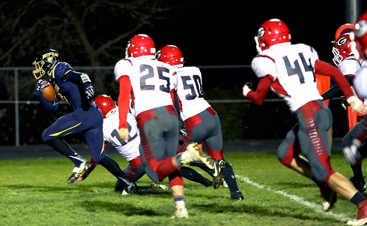 Rifle senior Tyler Bosshardt outruns Glenwood's defense for the fifth time in this year's 55-6 blowout. Bosshardt had 319 yards and five touchdowns on the night.