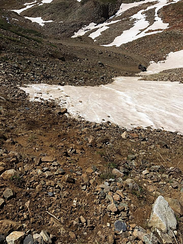 The slope that James Scully tumbled down in his Toyota FJ Cruiser on Saturday. The truck can be seen toward the top right side of the photograph near the edge of the switchback in the road, next to the snow.