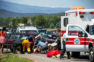 Rescuers remove Kathy Sharp from her vehicle after her vehcile was struck on the driver's side at the intersection of Highway 82 and Catherine Store Road.