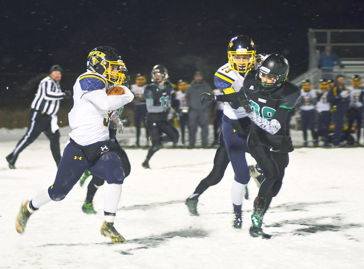 Rifle's Tyler Bosshardt breaks through tackles on his way to a touchdown in the second quarter of the Summit home closer on Nov. 6. The Tigers lost, 6-55.