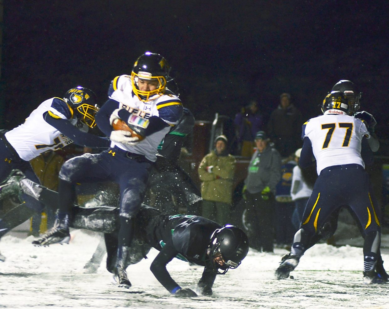 A Summit defender takes down a Rifle wide reciever in the Bears' 55-6 win on Friday.