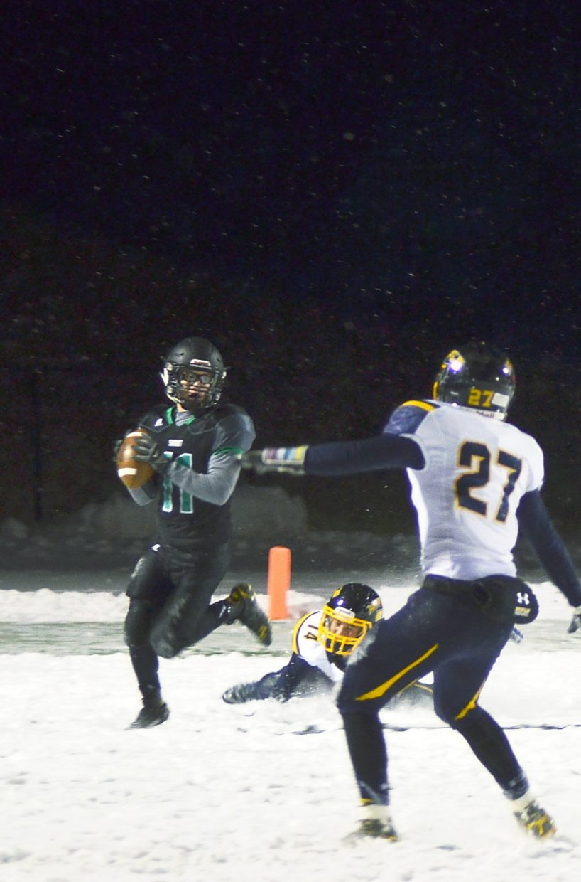 Summit quarterback Riley Beck looks for an open reciever in the third quarter of the home closer against Rifle, shot by @sumcosports