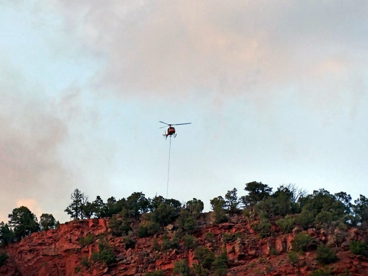Two helicopters were used to help fight the Red Canyon fire south of Glenwood Springs.