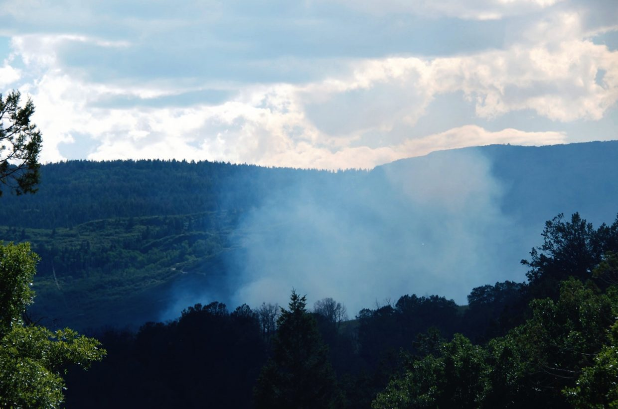 Smoke billowed over Red Canyon Road from a brush fire that began around 4 p.m. Friday and spread to about 6 acres.