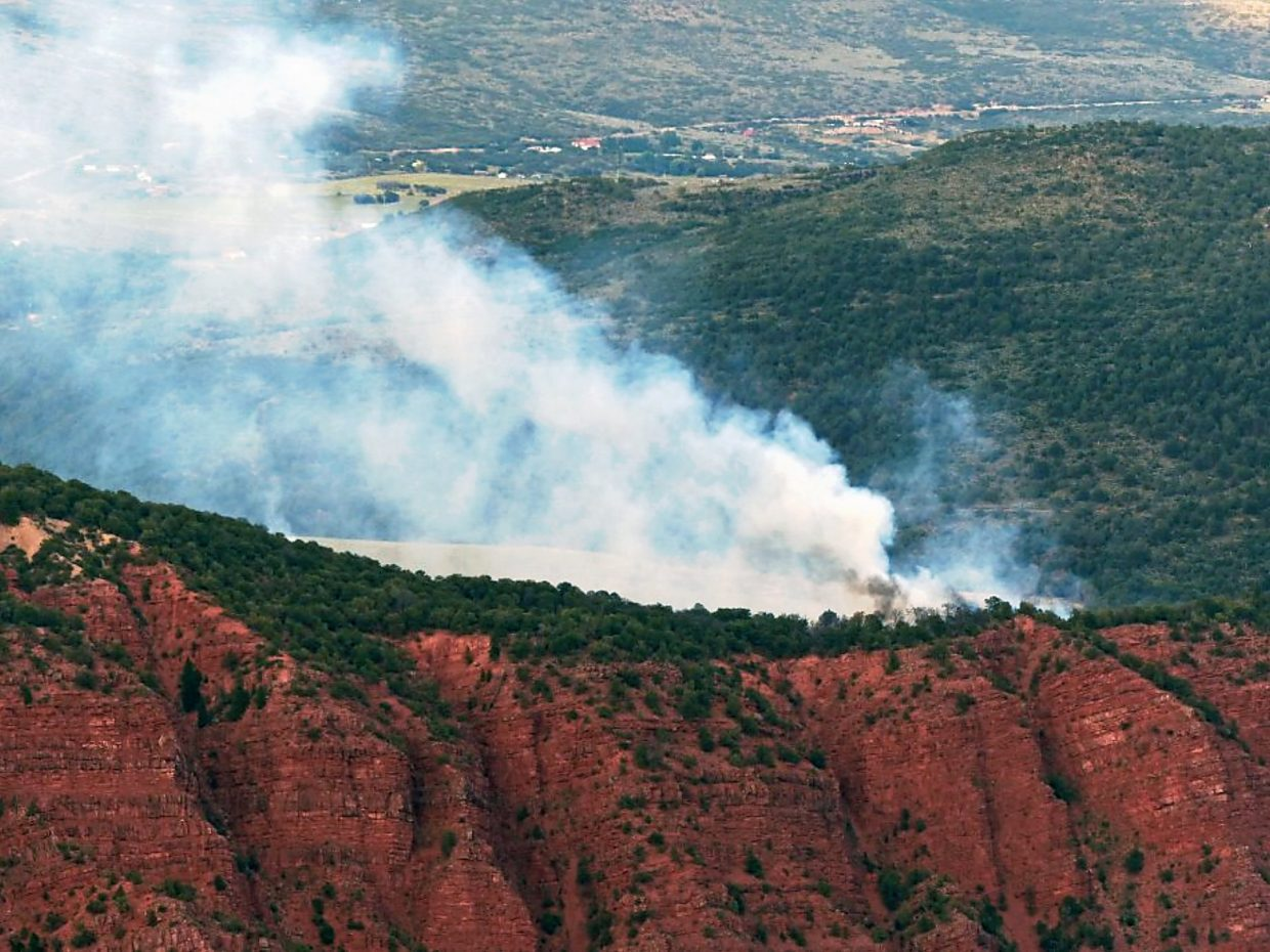Smoke rolls up from BLM land south of Glenwood Springs on Friday.