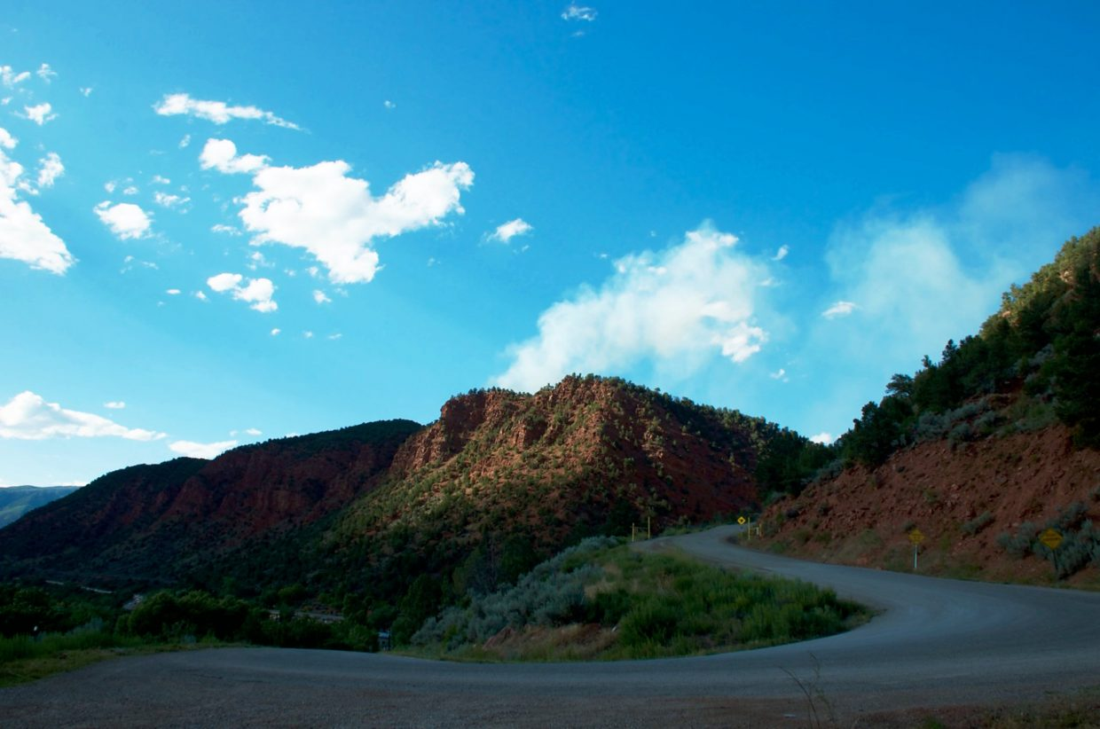 Smoke rises above Red Canyon Road on Friday afternoon.