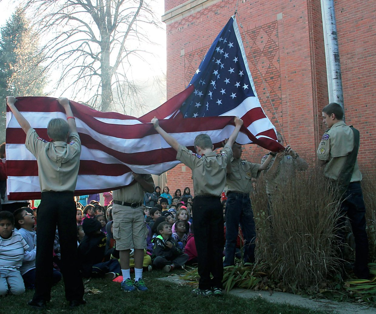 A new flag is raised by Boy Scout Troop 225 at Glenwood Springs Elementary School.
